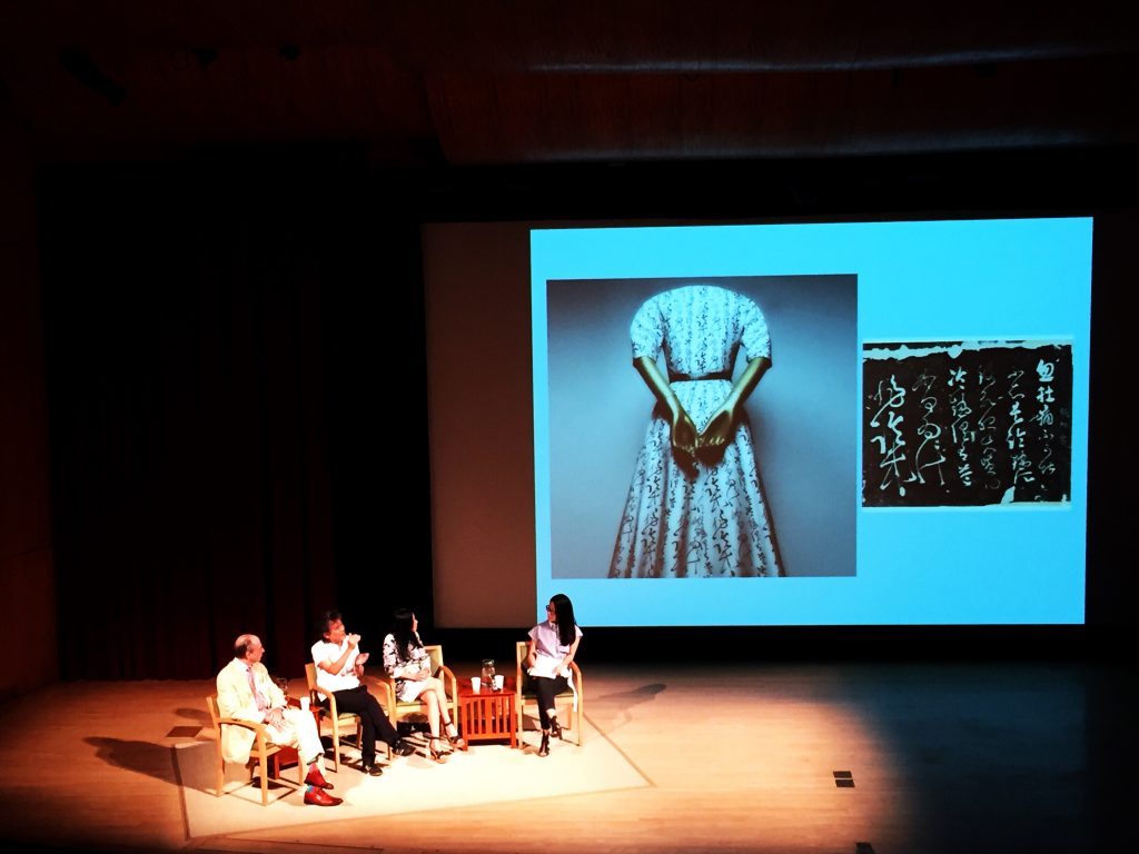 The panel, led by Elizabeth Peng, on stage at the MET's auditorium